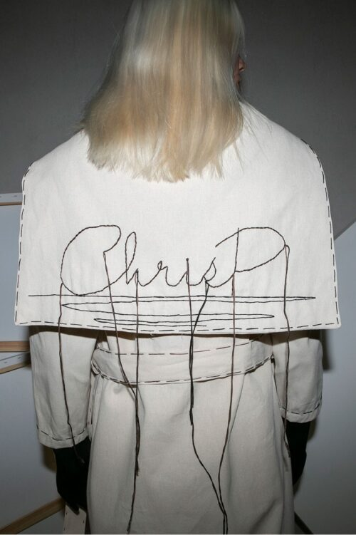 .  Trench coat, long sleeves, embroidered cape