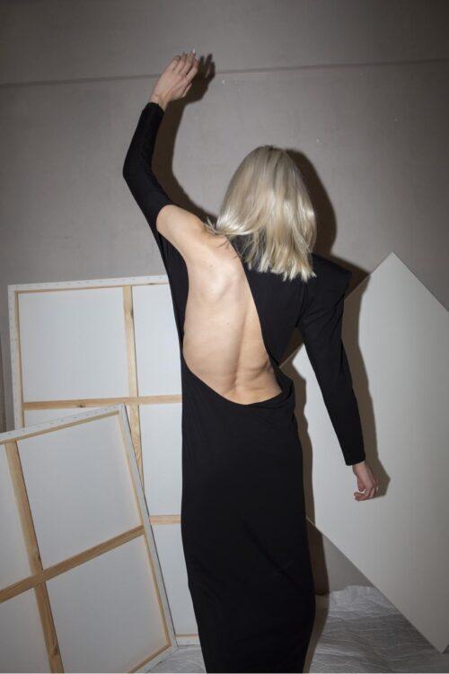 .  Long dress, one long sleeve, open back, turtle neck